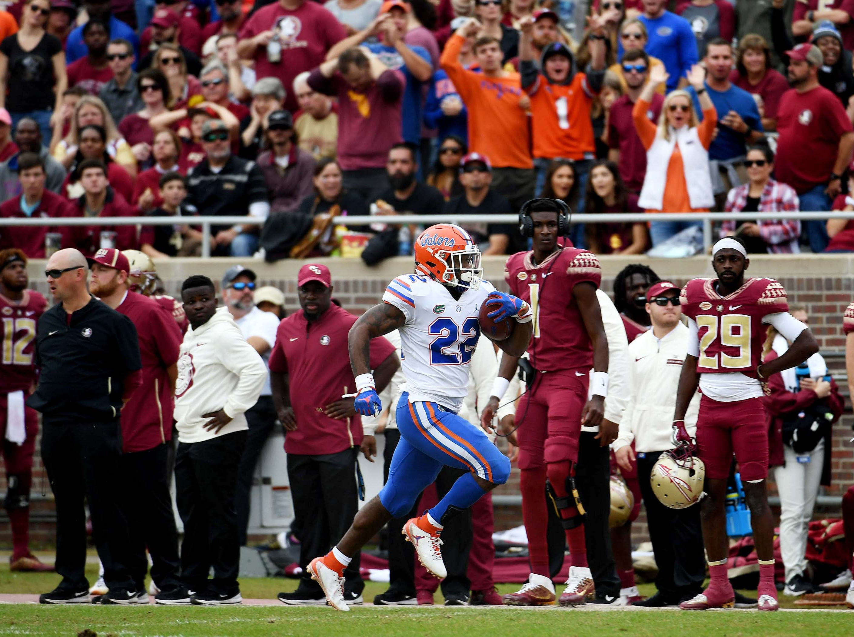 Nov 24, 2018; Tallahassee, FL, USA; Florida Gators running back Lamical Perine (22) runs the ball for a touchdown during the first half against the Florida State Seminoles at Doak Campbell Stadium. Mandatory Credit: Melina Myers-USA TODAY Sports