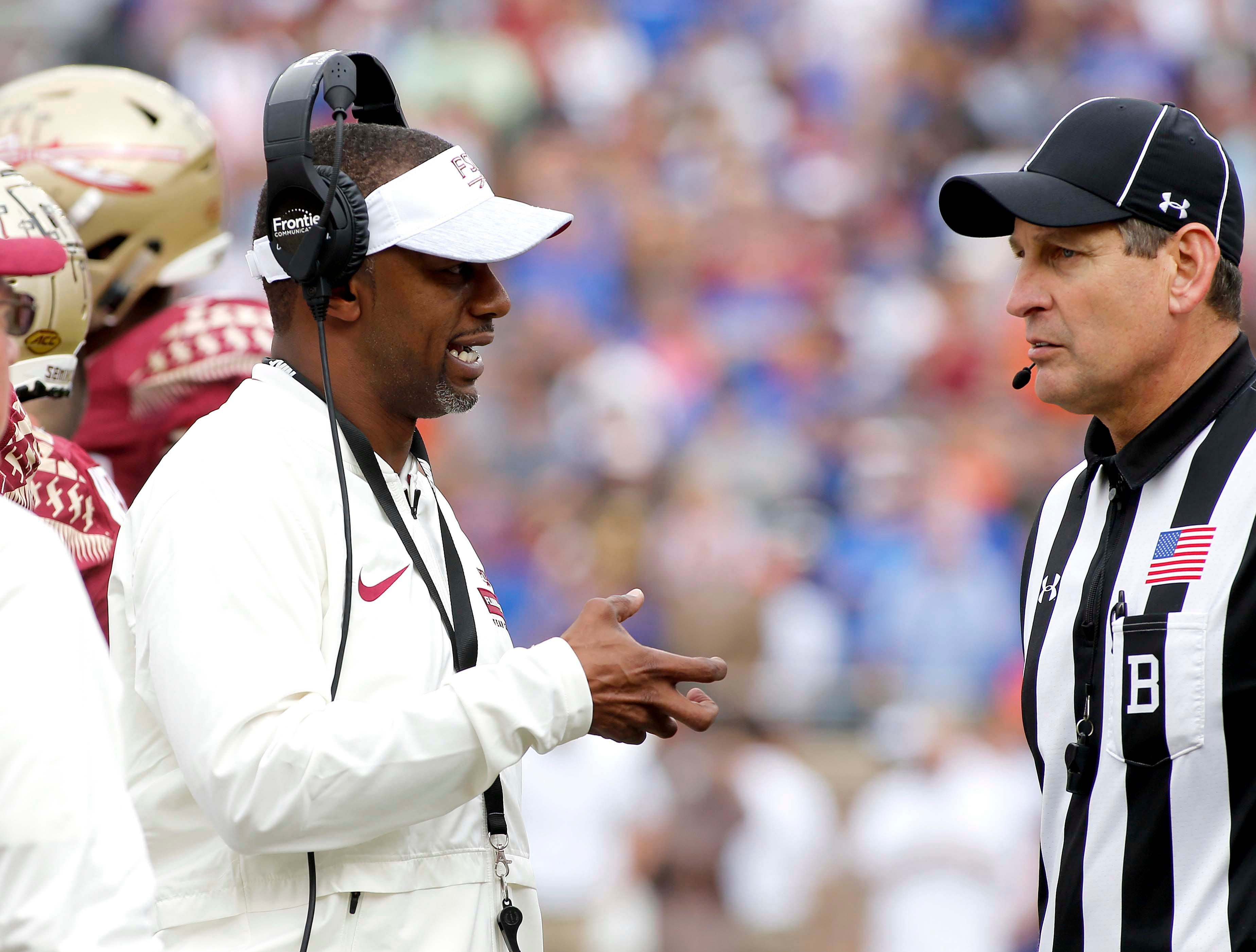 Nov 24, 2018; Tallahassee, FL, USA; Florida State Seminoles head coach Willie Taggart discusses a penalty with an official during the first half of action at Doak Campbell Stadium. Mandatory Credit: Glenn Beil-USA TODAY Sports
