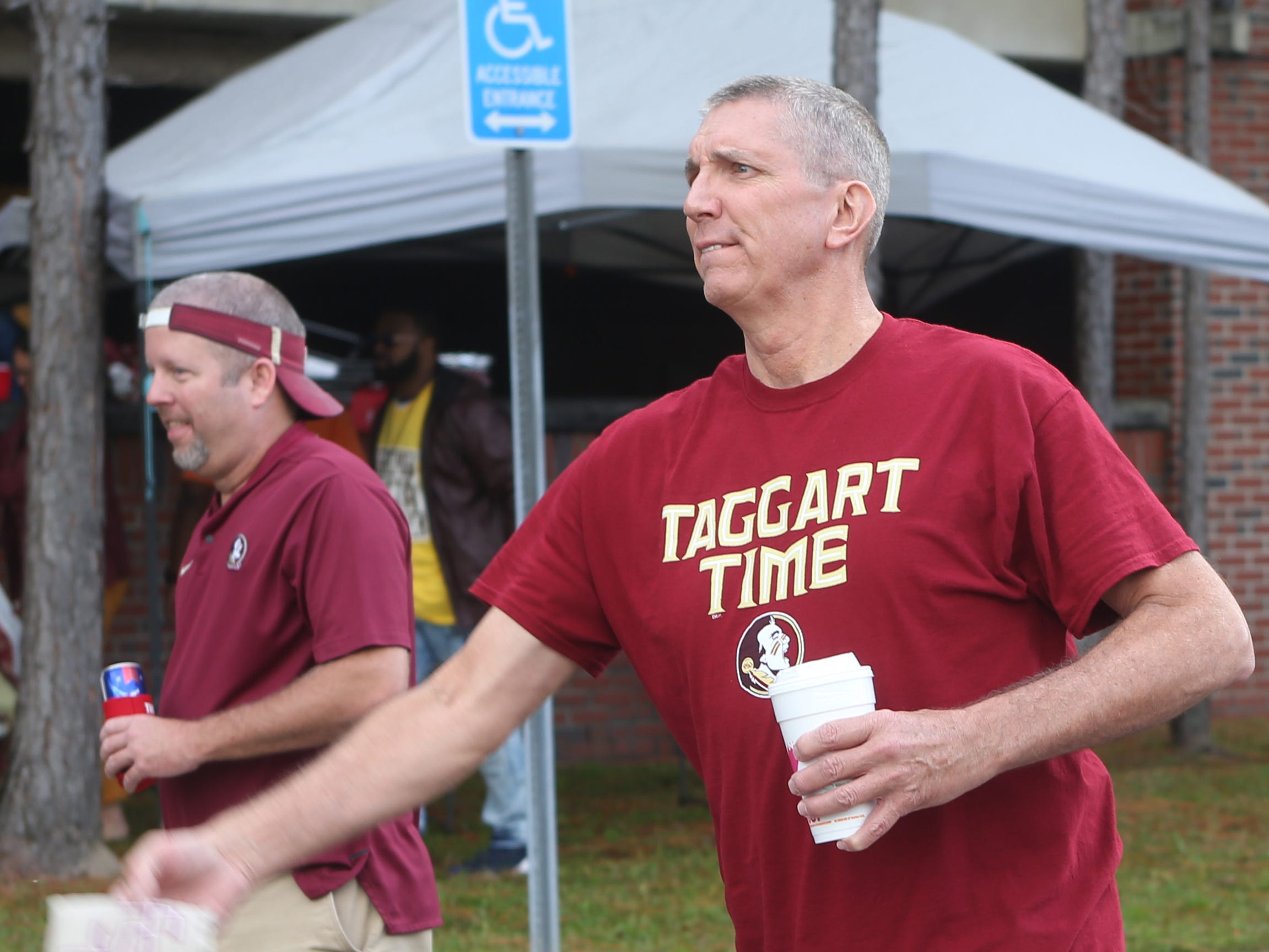 Seminole fans play corn hole as fans tailgate before the big rivalry game between the Florida State Seminoles and the Florida Gators, Saturday, Nov. 24, 2018.