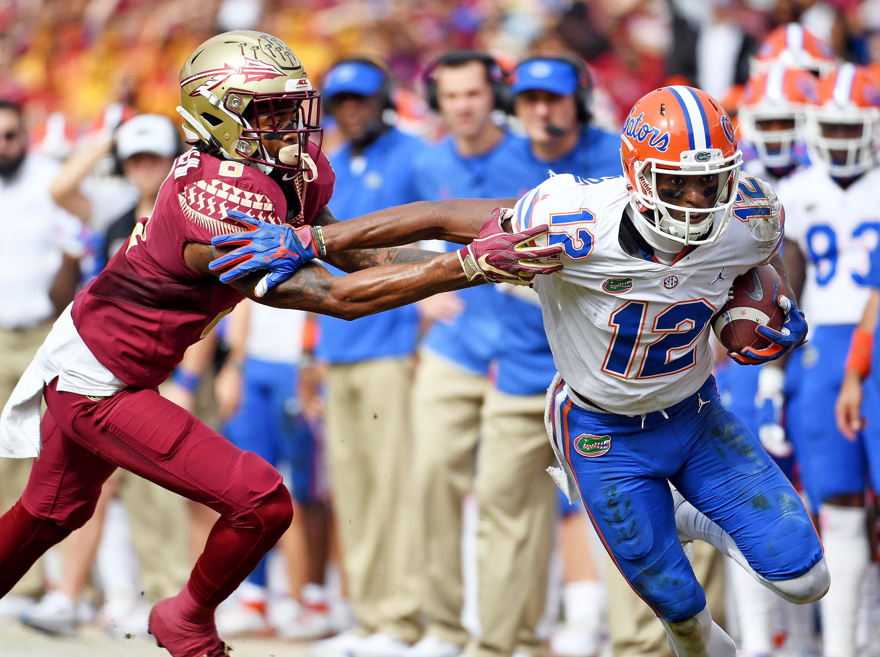 Nov 24, 2018; Tallahassee, FL, USA; Florida Gators wide receiver Van Jefferson (12) is defended by Florida State Seminoles defensive back Stanford Samuels III (8) during the first half at Doak Campbell Stadium. Mandatory Credit: Melina Myers-USA TODAY Sports