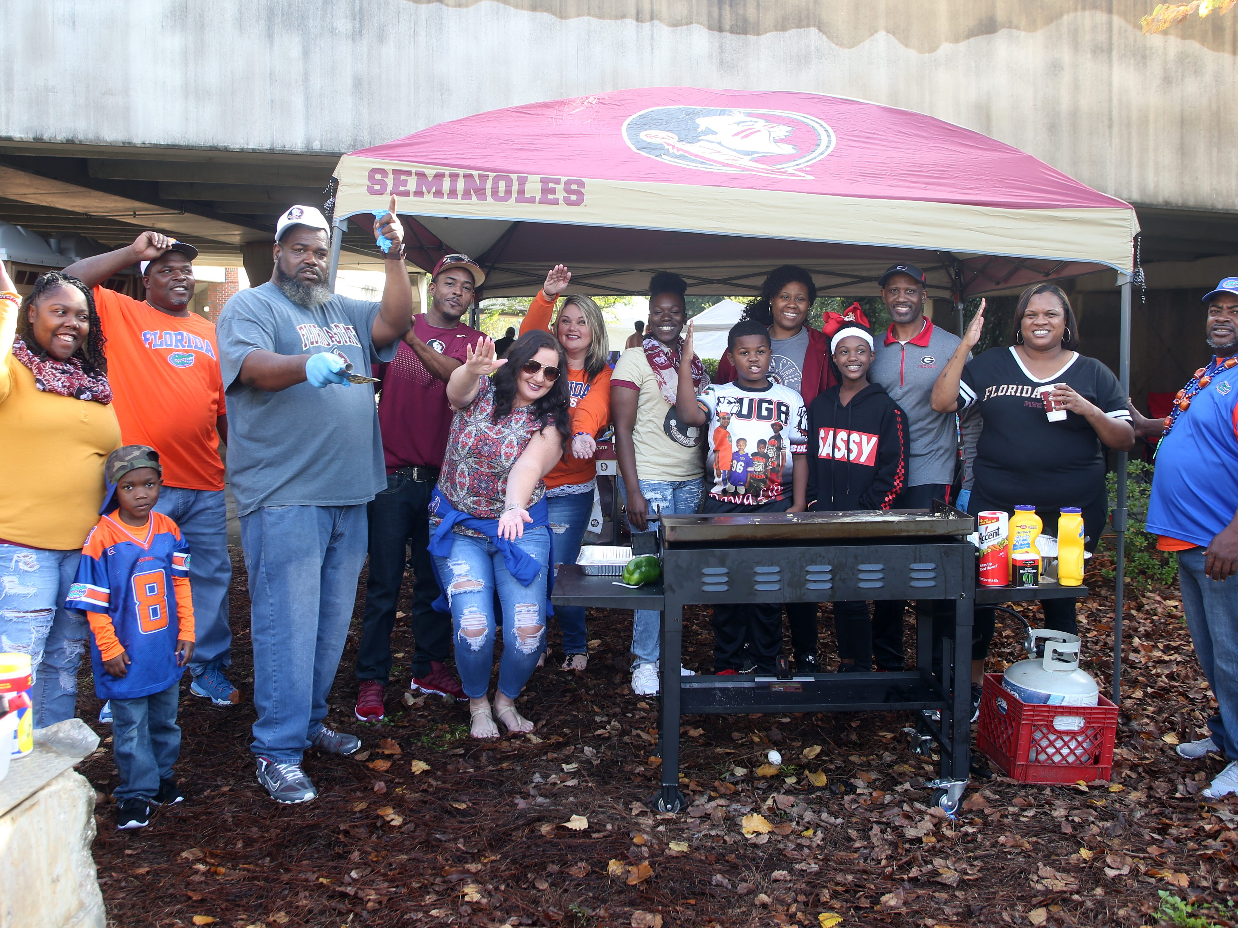 Gator and Seminole fans tailgate together before the big rivalry game between the Florida State Seminoles and the Florida Gators, Saturday, Nov. 24, 2018.