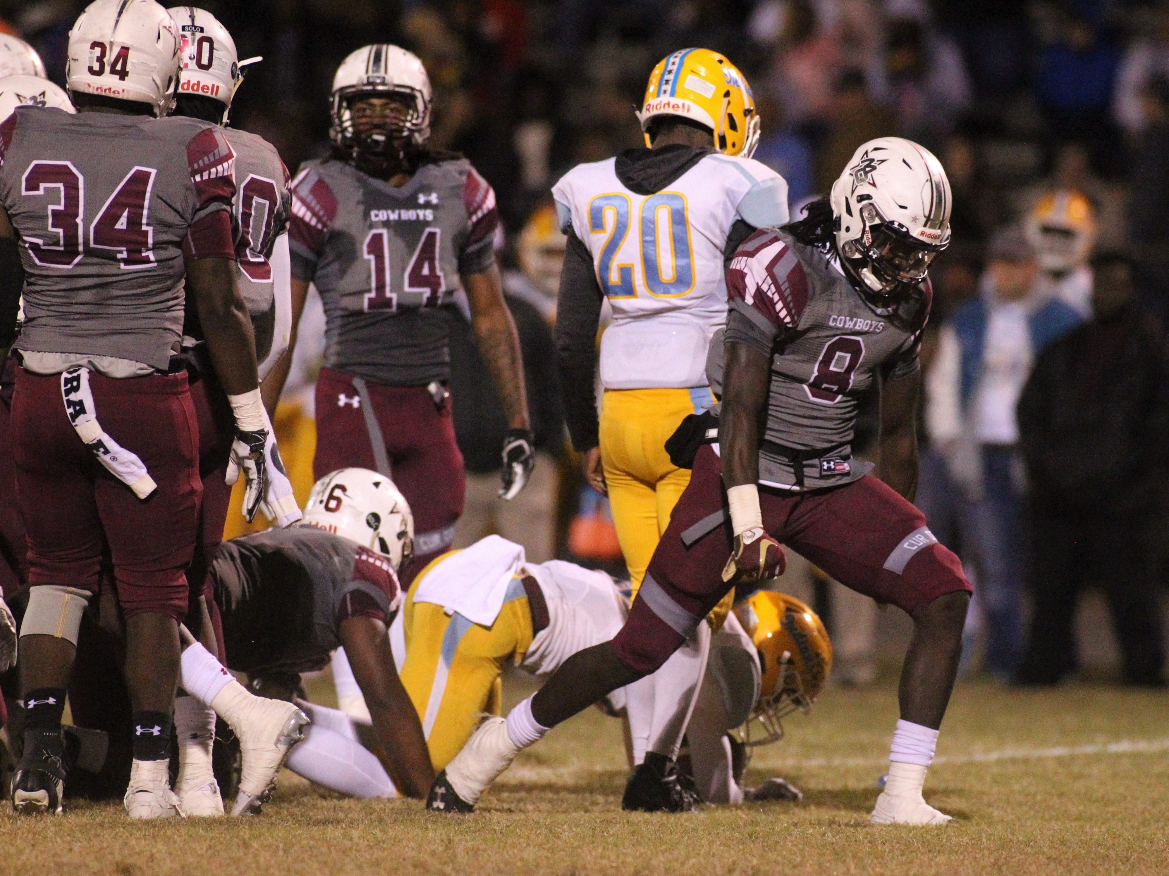 Madison County defensive back Travis Jay flexes after a big tackle as the Cowboys beat Chiefland 49-14 in a Region 3-1A final at Boot Hill Stadium on Friday, Nov. 23, 2018.