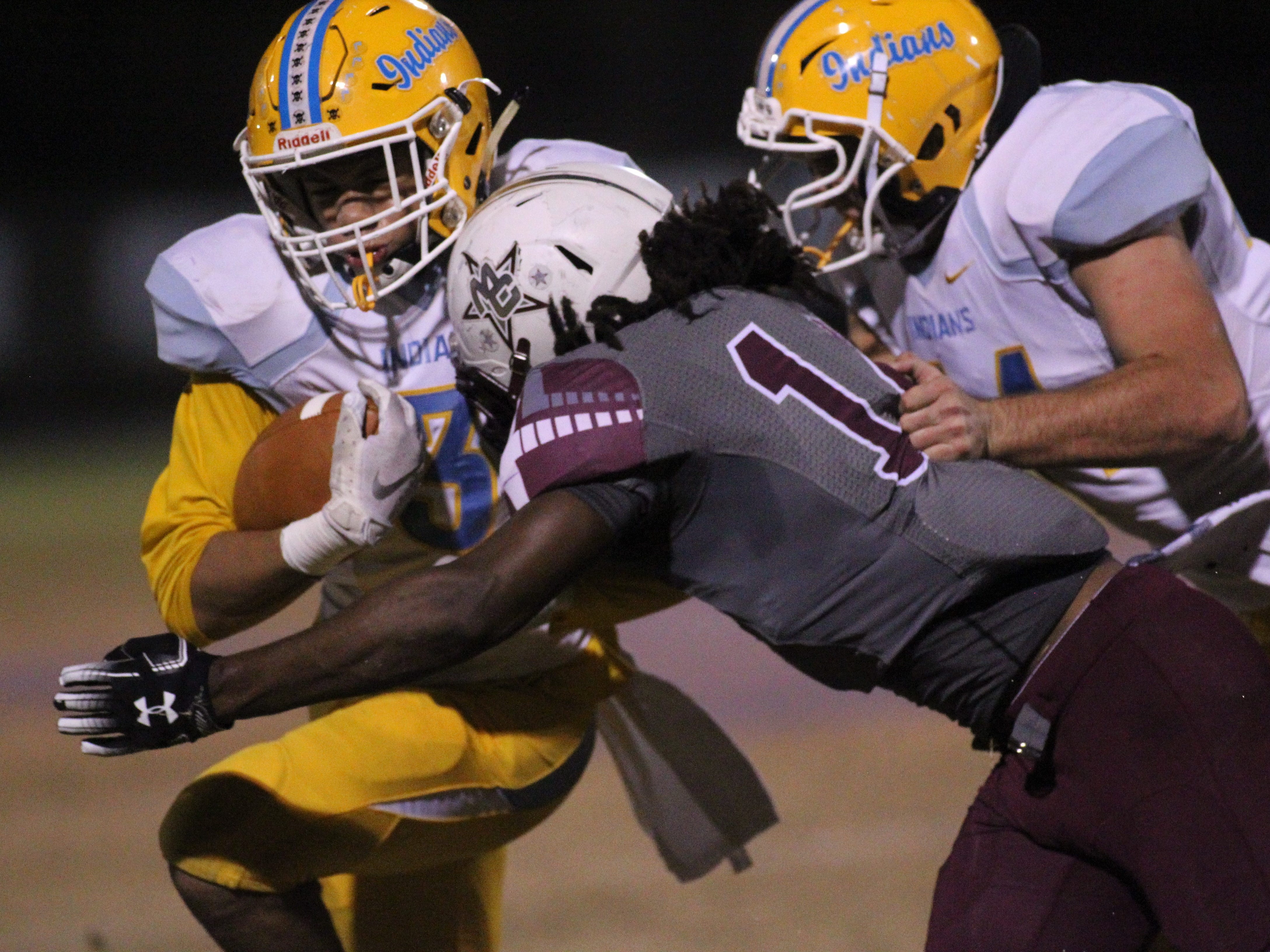 Madison County linebacker Melvin Brown lays a hit on Chiefland's Kirk Williams as the Cowboys beat Chiefland 49-14 in a Region 3-1A final at Boot Hill Stadium on Friday, Nov. 23, 2018.