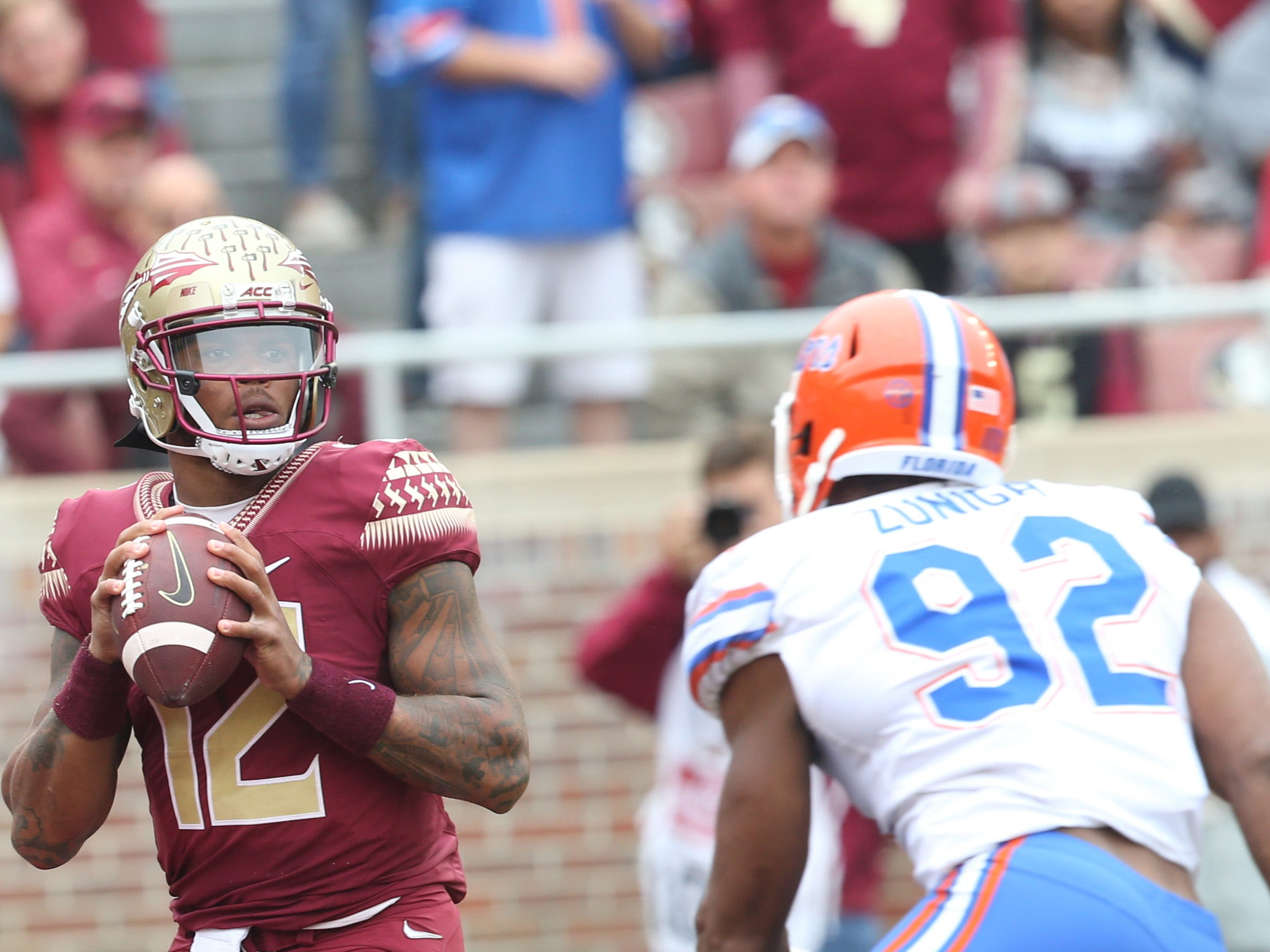 Florida State Seminoles quarterback Deondre Francois (12) looks to pass as the Florida State Seminoles take on their rival the Florida Gators in college football at Doak S. Campbell Stadium, Saturday, Nov. 24, 2018.