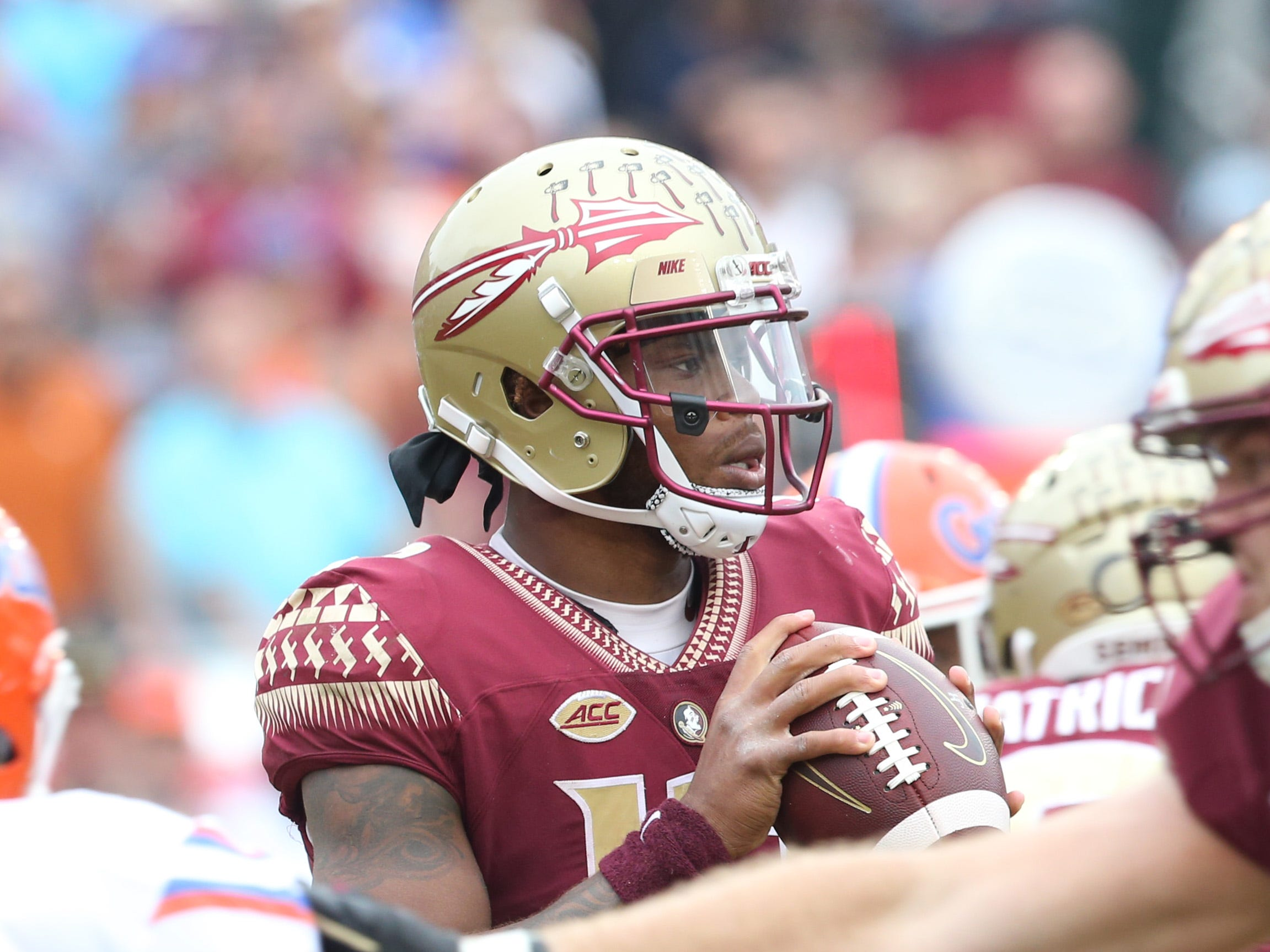 Florida State Seminoles quarterback Deondre Francois (12)looks to pass as the Florida State Seminoles take on their rival the Florida Gators in college football at Doak S. Campbell Stadium, Saturday, Nov. 24, 2018.