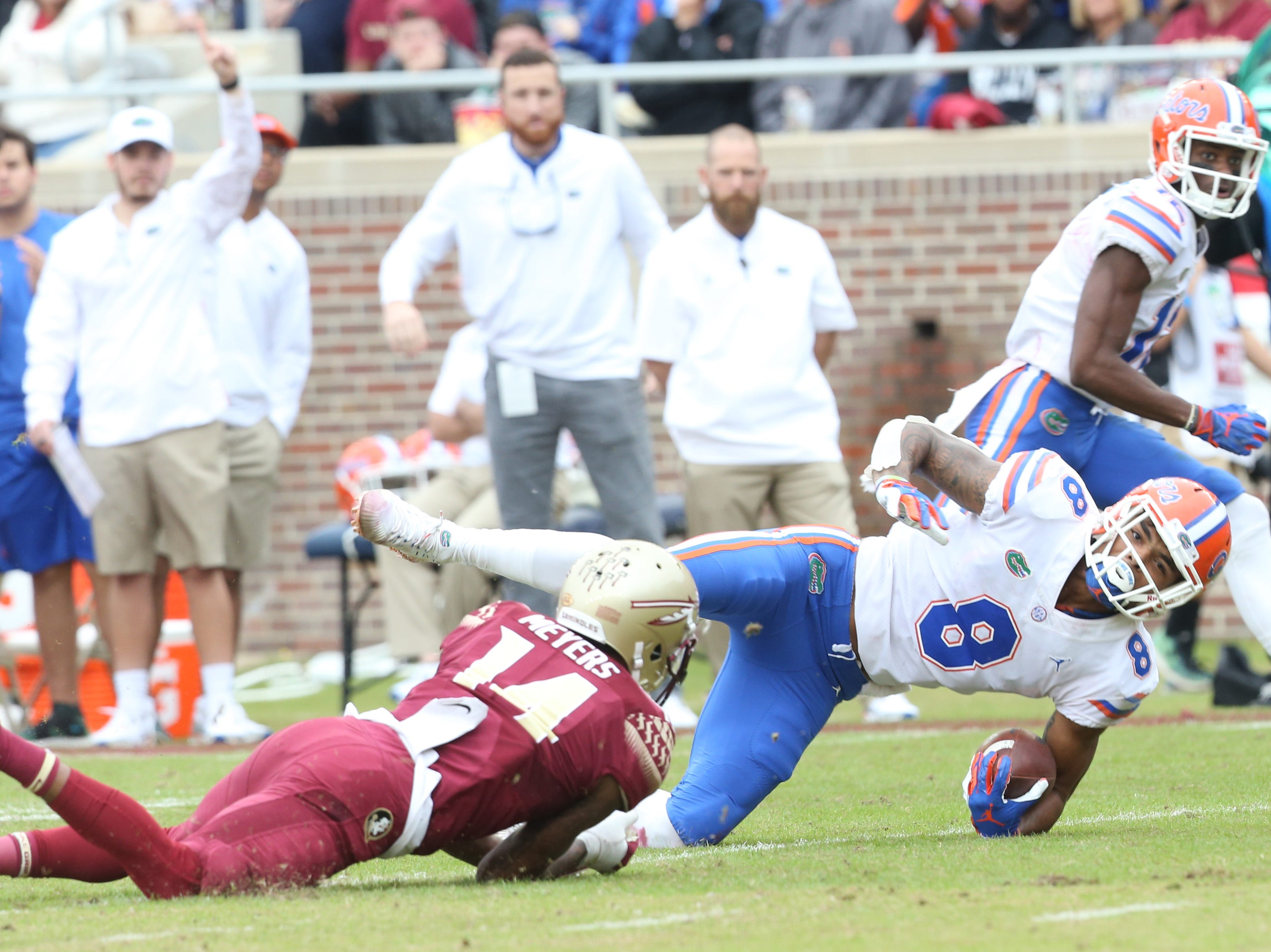 Florida Gators wide receiver Trevon Grimes (8) gets taken down by Florida State Seminoles defensive back Kyle Meyers (14) as the Florida State Seminoles take on their rival the Florida Gators in college football at Doak S. Campbell Stadium, Saturday, Nov. 24, 2018.