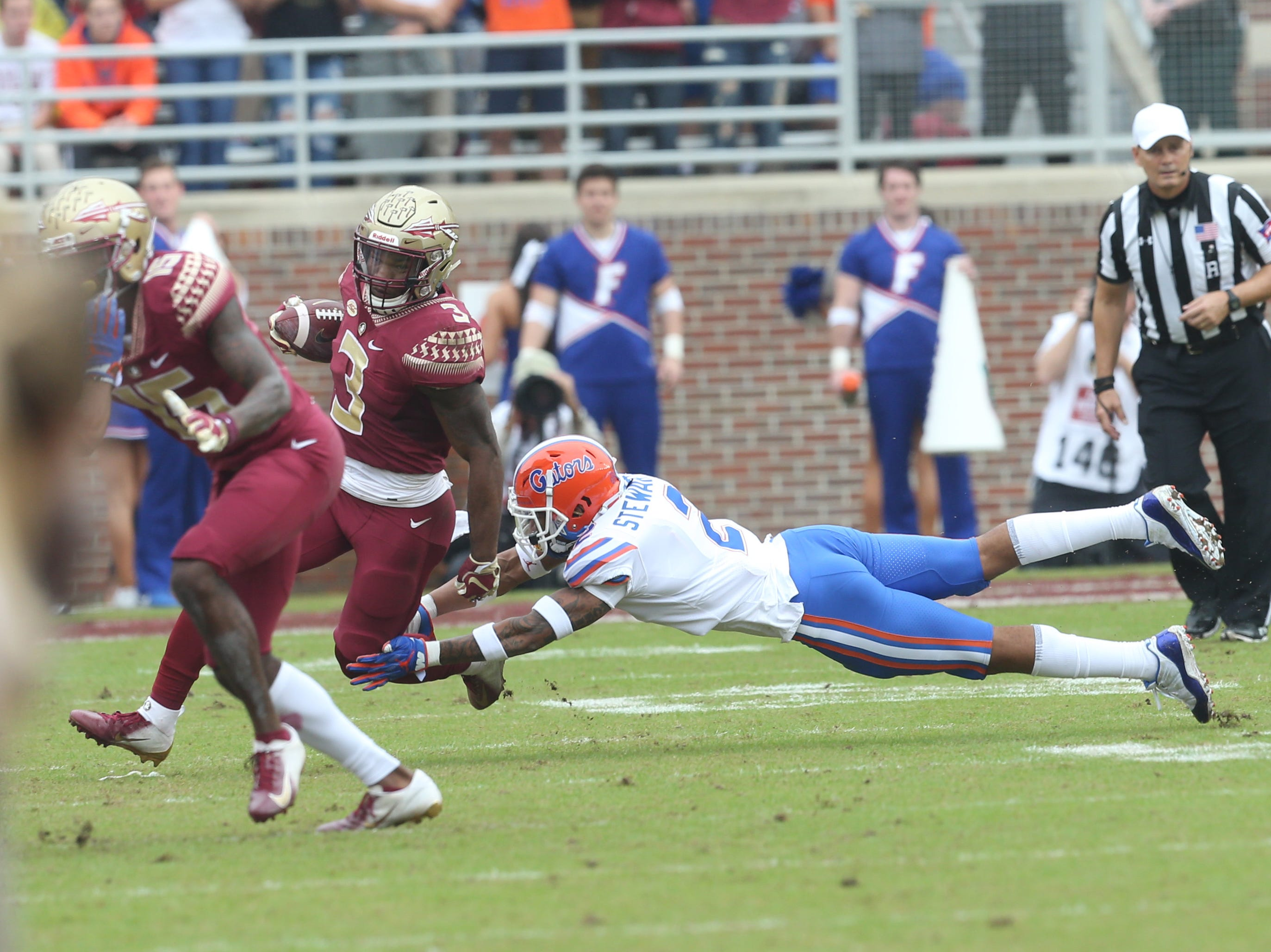 Florida State Seminoles running back Cam Akers (3) out runs a tackle as the Florida State Seminoles take on their rival the Florida Gators in college football at Doak S. Campbell Stadium, Saturday, Nov. 24, 2018.