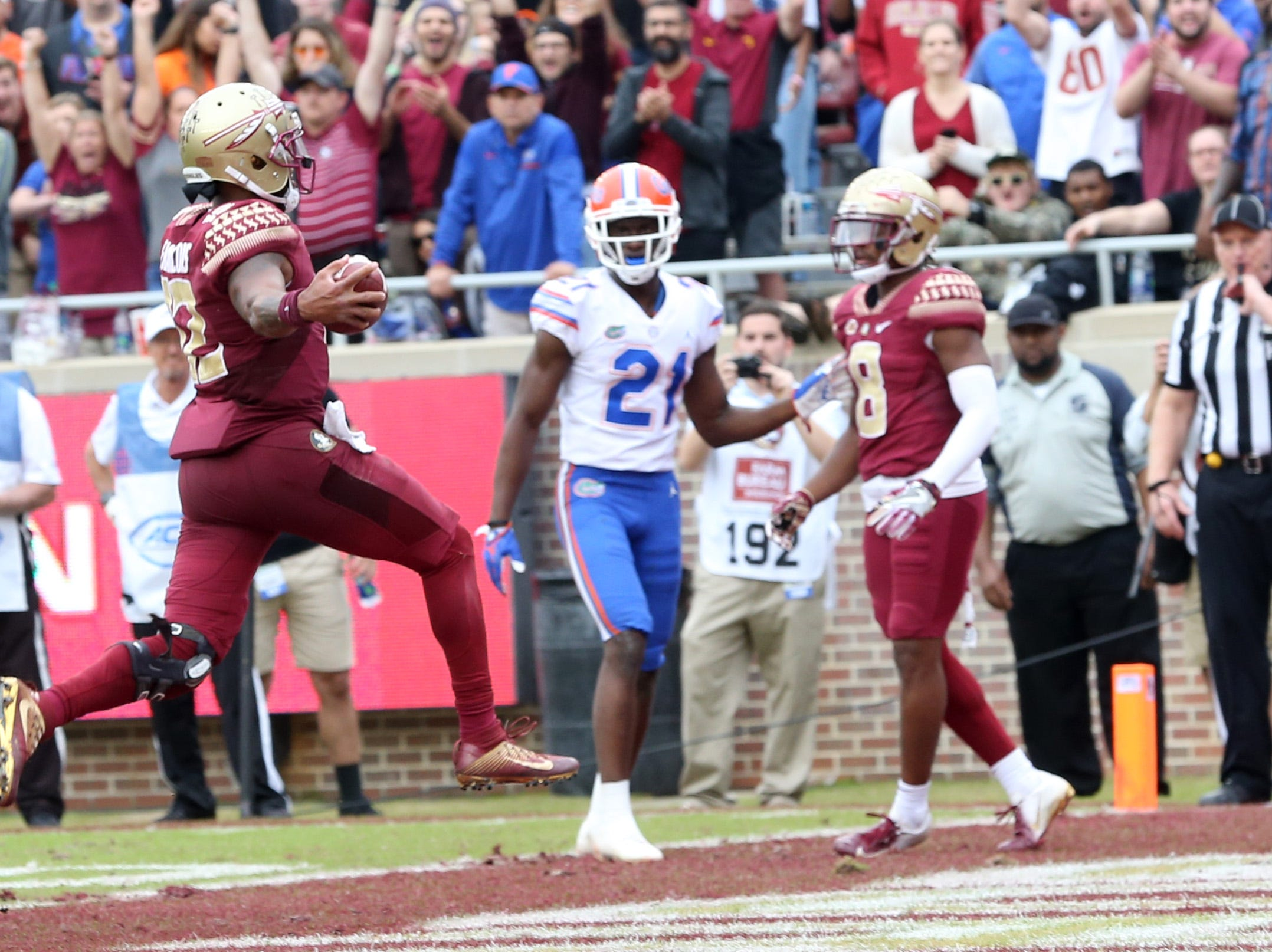 Florida State Seminoles quarterback Deondre Francois (12)  runs in for a touchdown as the Florida State Seminoles take on their rival the Florida Gators in college football at Doak S. Campbell Stadium, Saturday, Nov. 24, 2018.