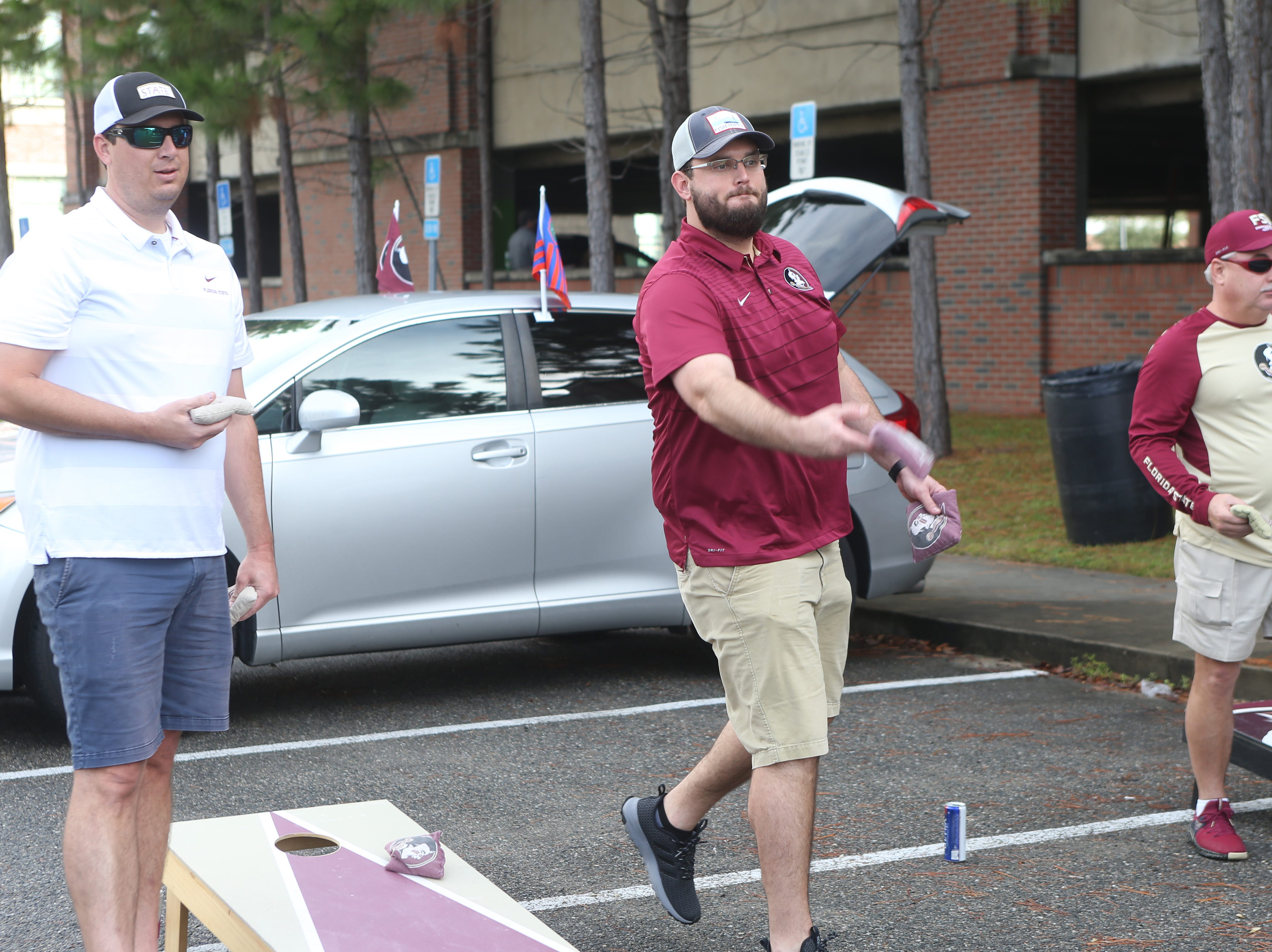 Fans play a lot corn hole as they tailgate before the big rivalry game between the Florida State Seminoles and the Florida Gators, Saturday, Nov. 24, 2018.