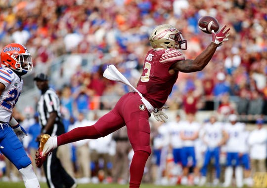 Nov 24, 2018; Tallahassee, FL, USA; Florida State Seminoles running back Cam Akers (3) makes a one handed touchdown catch in the first half against the Florida Gators at Doak Campbell Stadium. Mandatory Credit: Glenn Beil-USA TODAY Sports