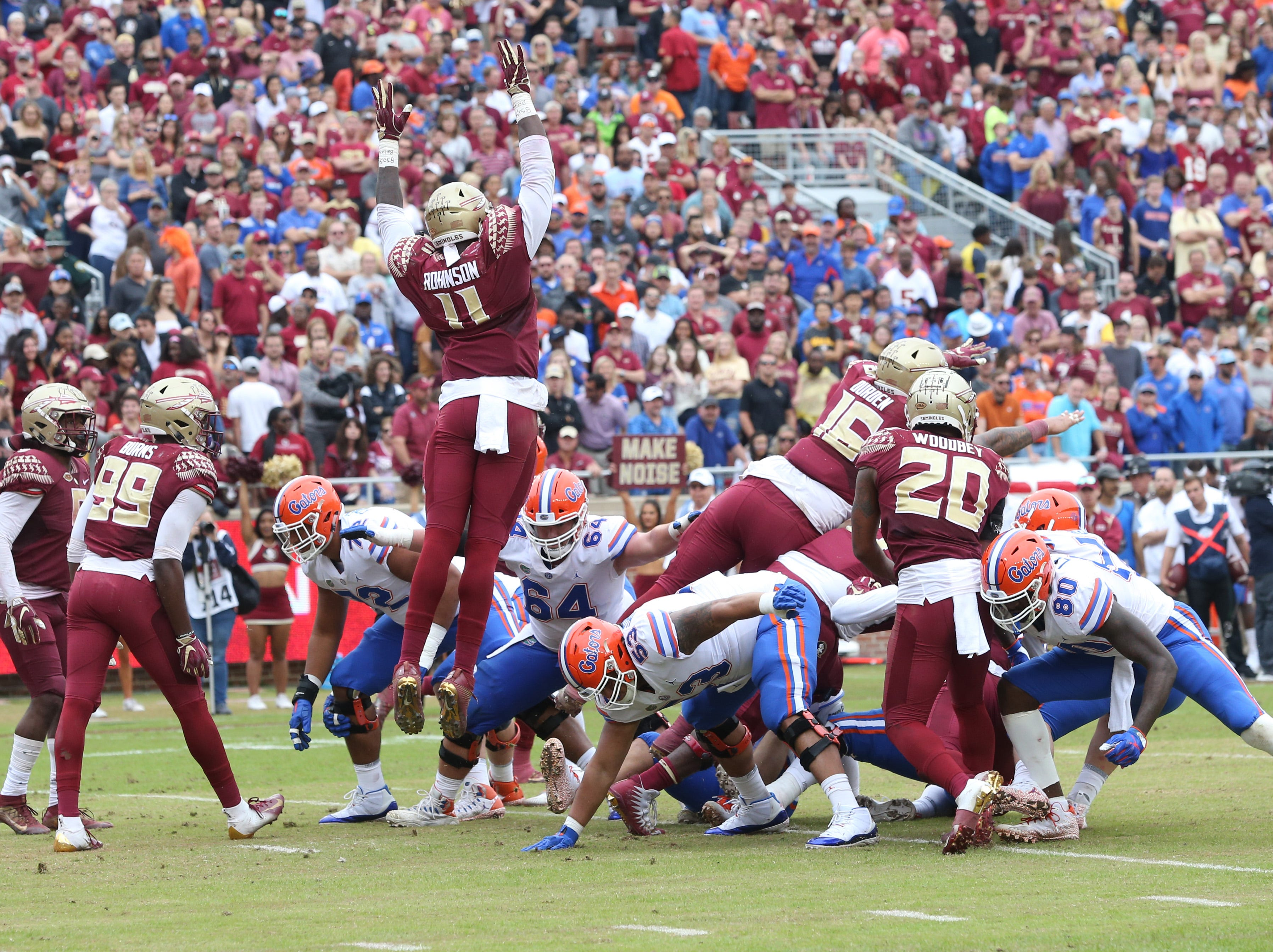 Florida State Seminoles defensive end Janarius Robinson (11) jumps while trying to block the extra point as the Florida State Seminoles take on their rival the Florida Gators in college football at Doak S. Campbell Stadium, Saturday, Nov. 24, 2018.