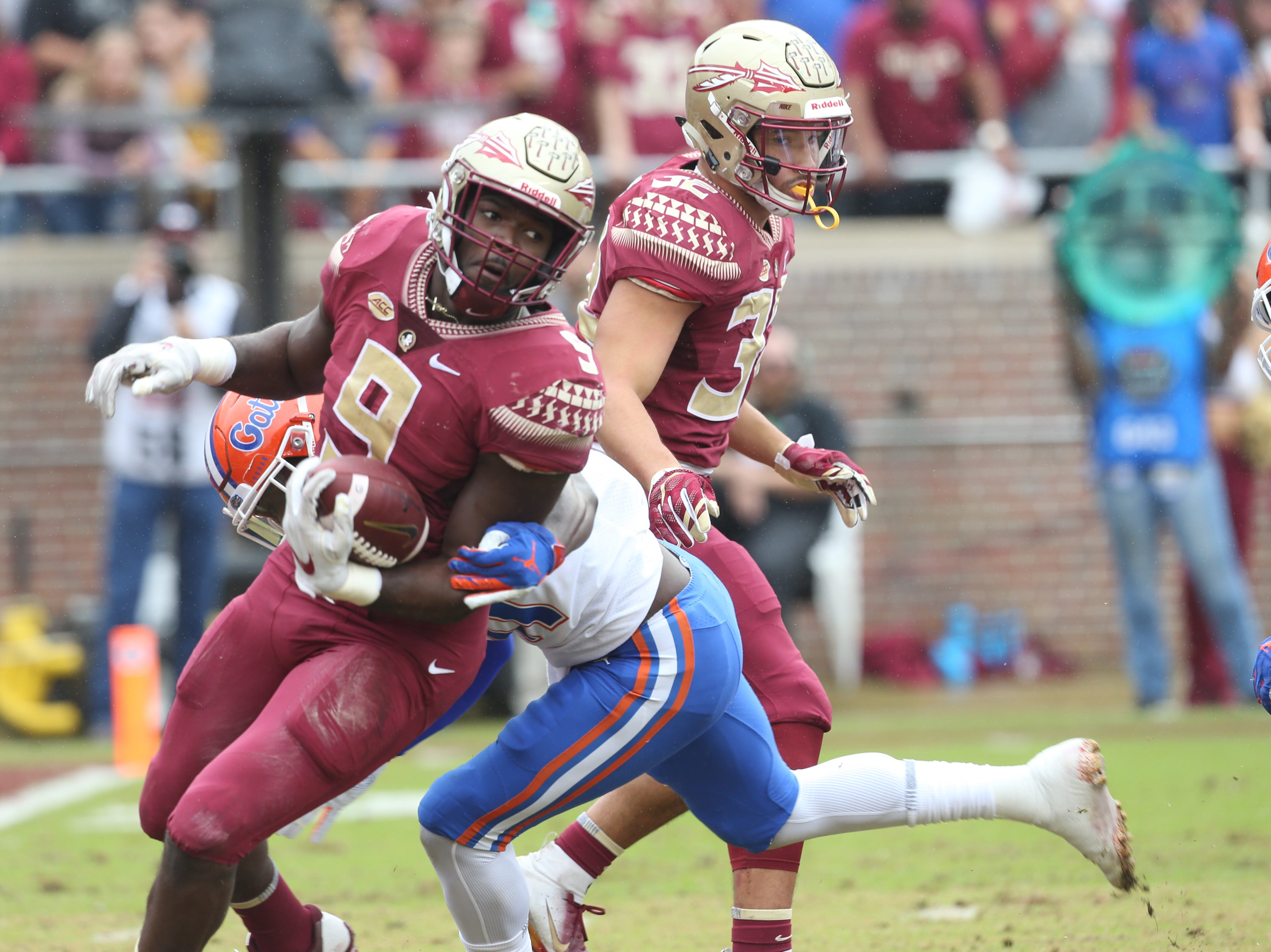 Florida State Seminoles running back Jacques Patrick (9) fights off a tackle as the Florida State Seminoles take on their rival the Florida Gators in college football at Doak S. Campbell Stadium, Saturday, Nov. 24, 2018.
