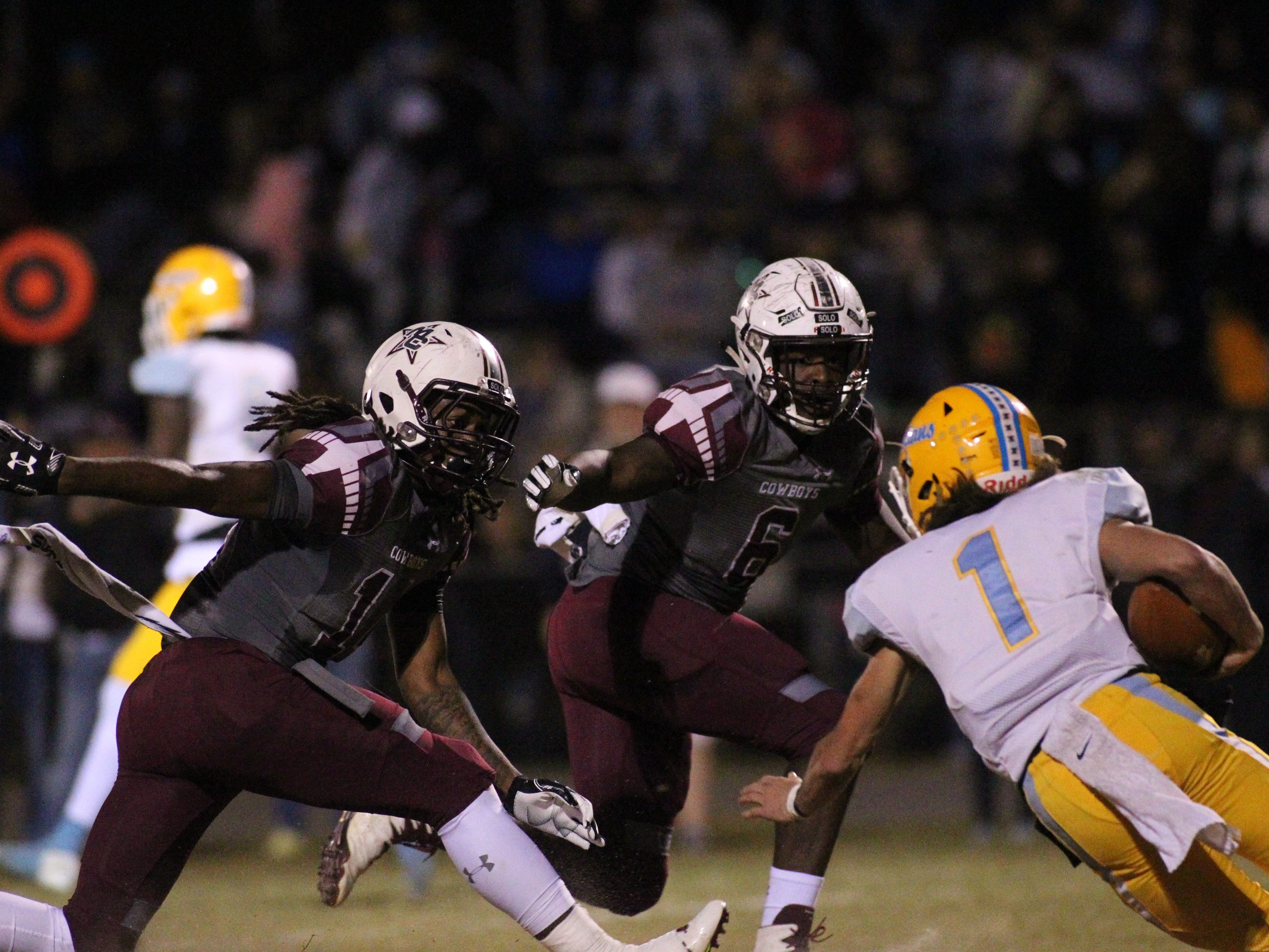 Chiefland quarterback Ty Corbin can't escape Madison County's Melvin Brown (14) and Patrick Hampton (6) as Madison County beat Chiefland 49-14 in a Region 3-1A final at Boot Hill Stadium on Friday, Nov. 23, 2018.