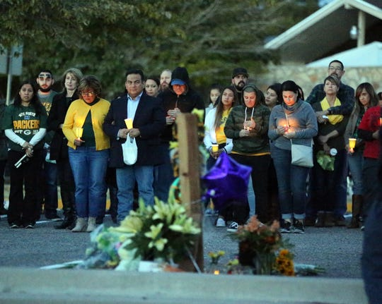 "Fellow educators, students and others attend a memorial vigil outside Eastwood Heights Elementary School on Nov. 23 for teacher Amanda ""Mandy"" Weyant Ferguson, 28, who died from injuries suffered Nov. 22 in the Cincinnati Entertainment District of West El Paso when she was struck by a car while crossing Mesa Street at a crosswalk."