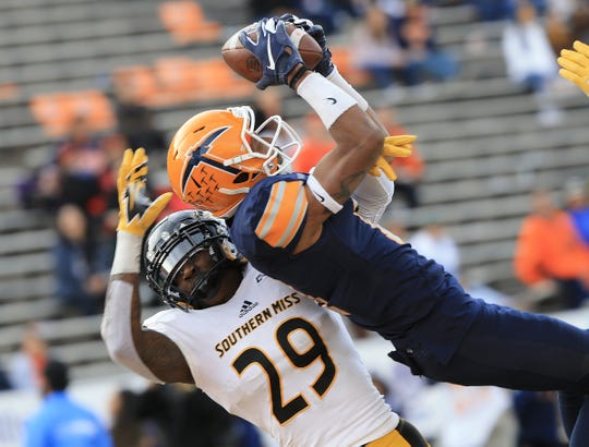 UTEP wide receiver Erik Brown catches the team's only touchdown pass over Ernest Gunn against Southern Miss Saturday at the Sun Bowl.