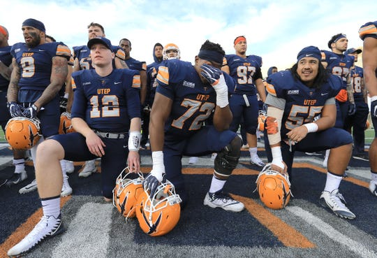 UTEP senior offensive lineman Jerrod Brooks wipes tears from his eyes as he, senior quarterback Ryan Metz, left, and senior Mike Sota watch the senior film following their game against Southern Miss Saturday at the Sun Bowl.