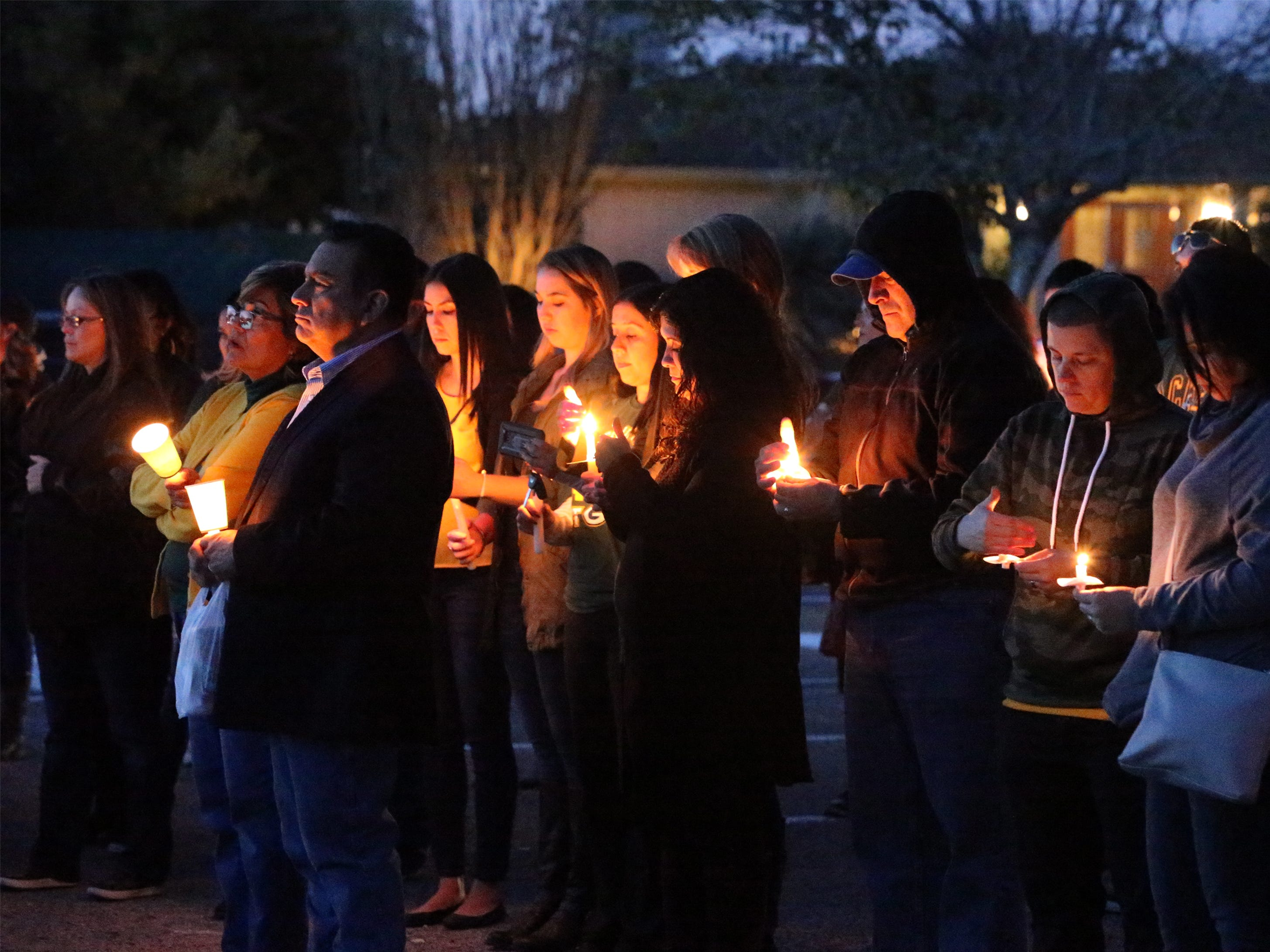 "Fellow educators, students and others attend a memorial vigil outside Eastwood Heights Elementary School Friday evening for teacher Amanda ""Mandy"" Weyant Ferguson, 28, who died from injuries suffered Thursday morning in the Cincinnati Entertainment District of West El Paso when she was struck by a car while crossing Mesa Street at a crosswalk."