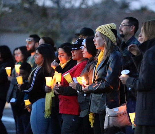 """Fellow educators, students and others attend a memorial vigil outside Eastwood Heights Elementary School on Nov. 23 for teacher Amanda """"Mandy"""" Weyant Ferguson, 28, who died from injuries sufferedNov. 22 in the Cincinnati Entertainment District of West El Paso when she was struck by a car while crossing Mesa Street at a crosswalk."""