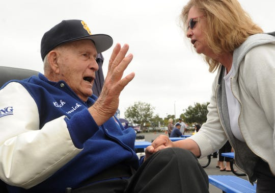 "Lou Cvijanovich, left, talks with Mary Mullen during a ceremony in 2012 to name part of Laurel Street in Oxnard to ""Coach C Lane."""