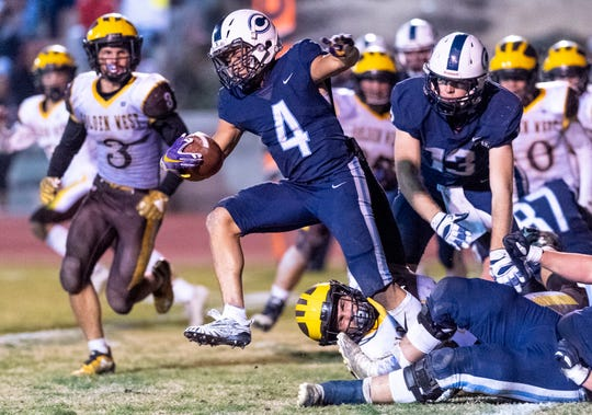 Central Valley Christian's Jaalen Rening runs against Golden West in a Central Section Division IV championship high school football game on Friday, November 23, 2018. Keith, Michelle and Kennedy.