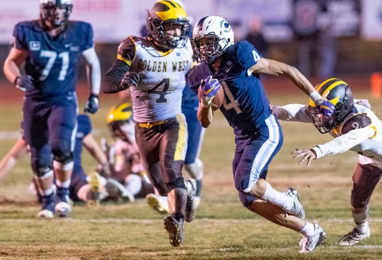 Central Valley Christian's Jaalen Rening runs against Golden West in a Central Section Division IV championship high school football game on Friday, November 23, 2018.