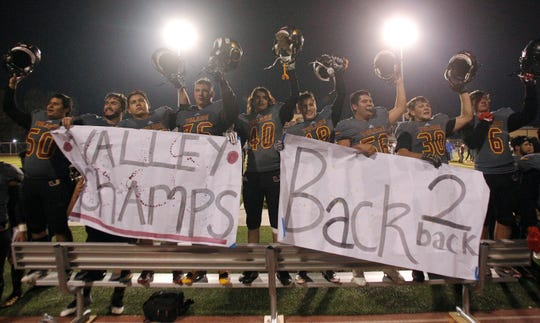 Tulare Union celebrates a valley championship against Righetti in Tulare, Calif., Friday, Nov. 23, 2018.