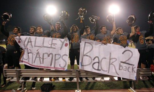 Tulare Union celebrates a valley championship against Righetti in Tulare, Calif., Friday, Nov. 23, 2018.