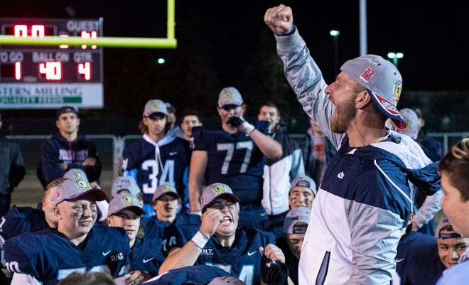 Coach Mason Hughes celebrates Central Valley Christian's victory over Golden West in a Central Section Division IV championship high school football game on Friday, November 23, 2018.