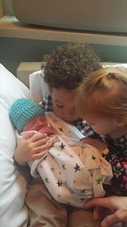 Bernard, 3, and Bianca, 18 months, check out their new baby brother, Boston Sosa Koltz, who was born Thursday.