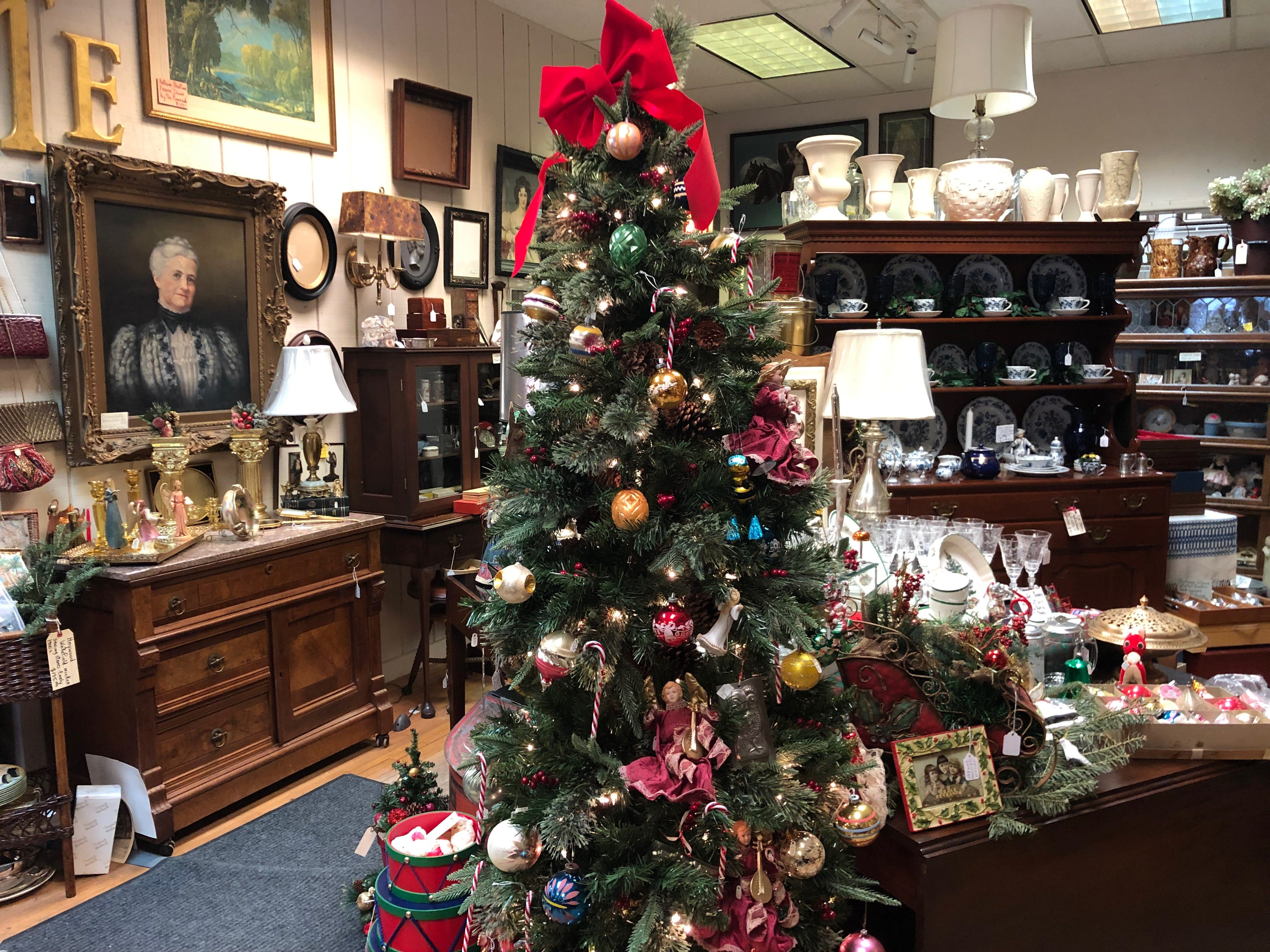 A Christmas tree brings cheer to Ginny's Antiques on Small Business Saturday.