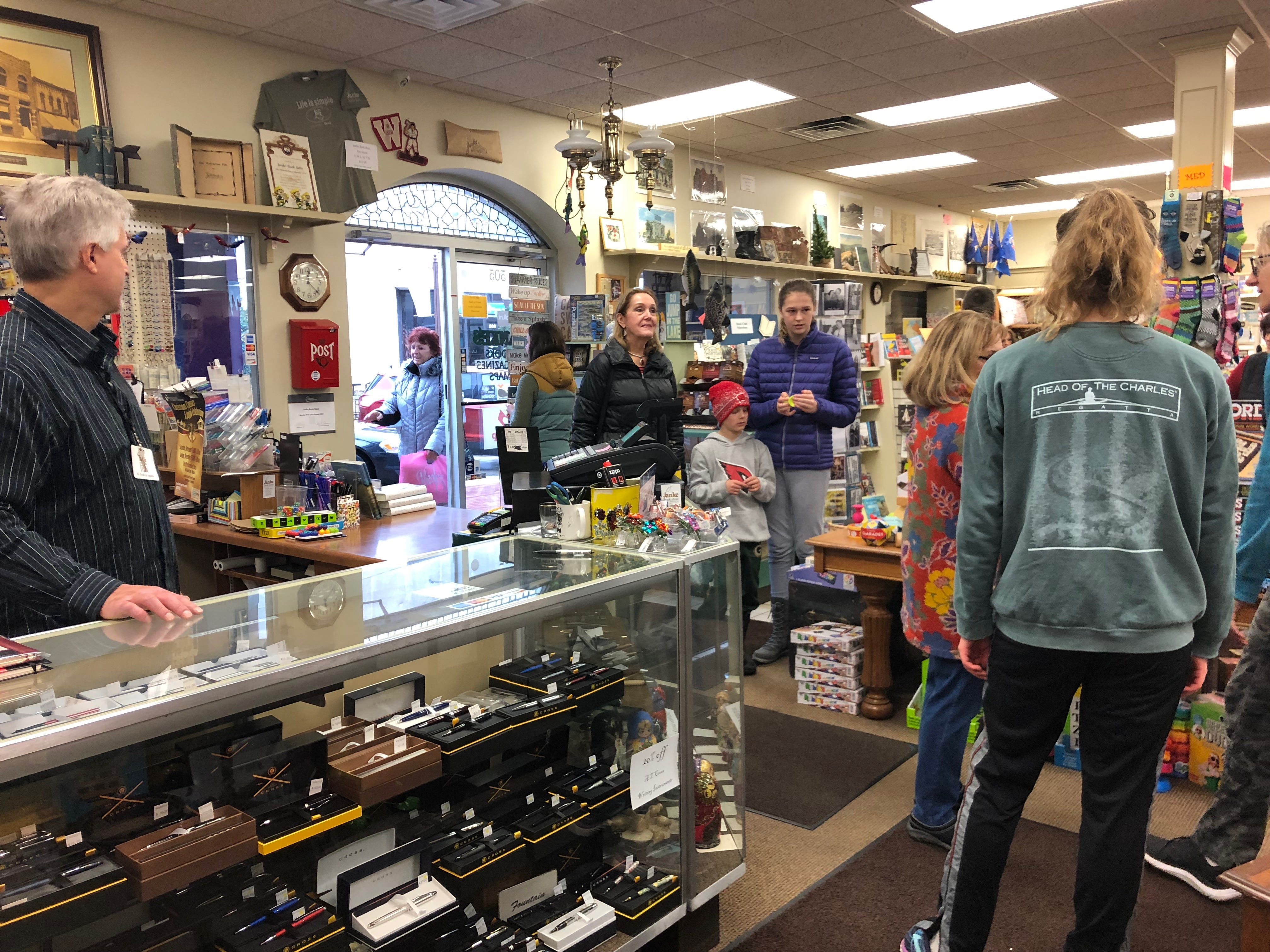 Customers gather and chat on Small Business Saturday at Janke Bookstore.