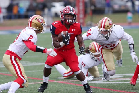 Archbishop Stepinac's Malik Grant (4) runs for a first half touchdown against Saint Francis in the CHSAA state  football championship at Stepinac High School in White Plains Nov. 24, 2018. Stepinac won the game.
