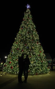 Robert Monteleone and Andrea Pena take a selfie in front of the Christmas tree at Westchester's Winter Wonderland at Kensico Dam Plaza.
