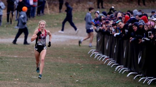 Katelyn Tuohy of North Rockland High School runs by herself as she nears the finish line during the Nike Cross Regional New York Championship Cross Country meet at Bowdoin Park in Wappingers Falls Nov. 24, 2018. Tuohy started out in front and relinquished the lead as she went on to finish first in the race.
