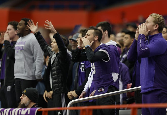 """New Rochelle fans yell, """"Defense!"""" during the Class A football championship game between Aquinas Institute and New Rochelle at the Carrier Dome in Syracuse on Nov. 24, 2018."""