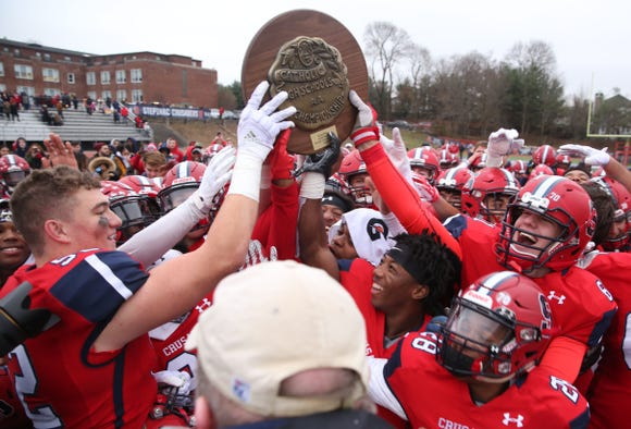 Archbishop Stepinac players celebrate with the championship plaque after defeating  Saint Francis in the CHSAA state  football championship at Stepinac High School in White Plains Nov. 24, 2018.