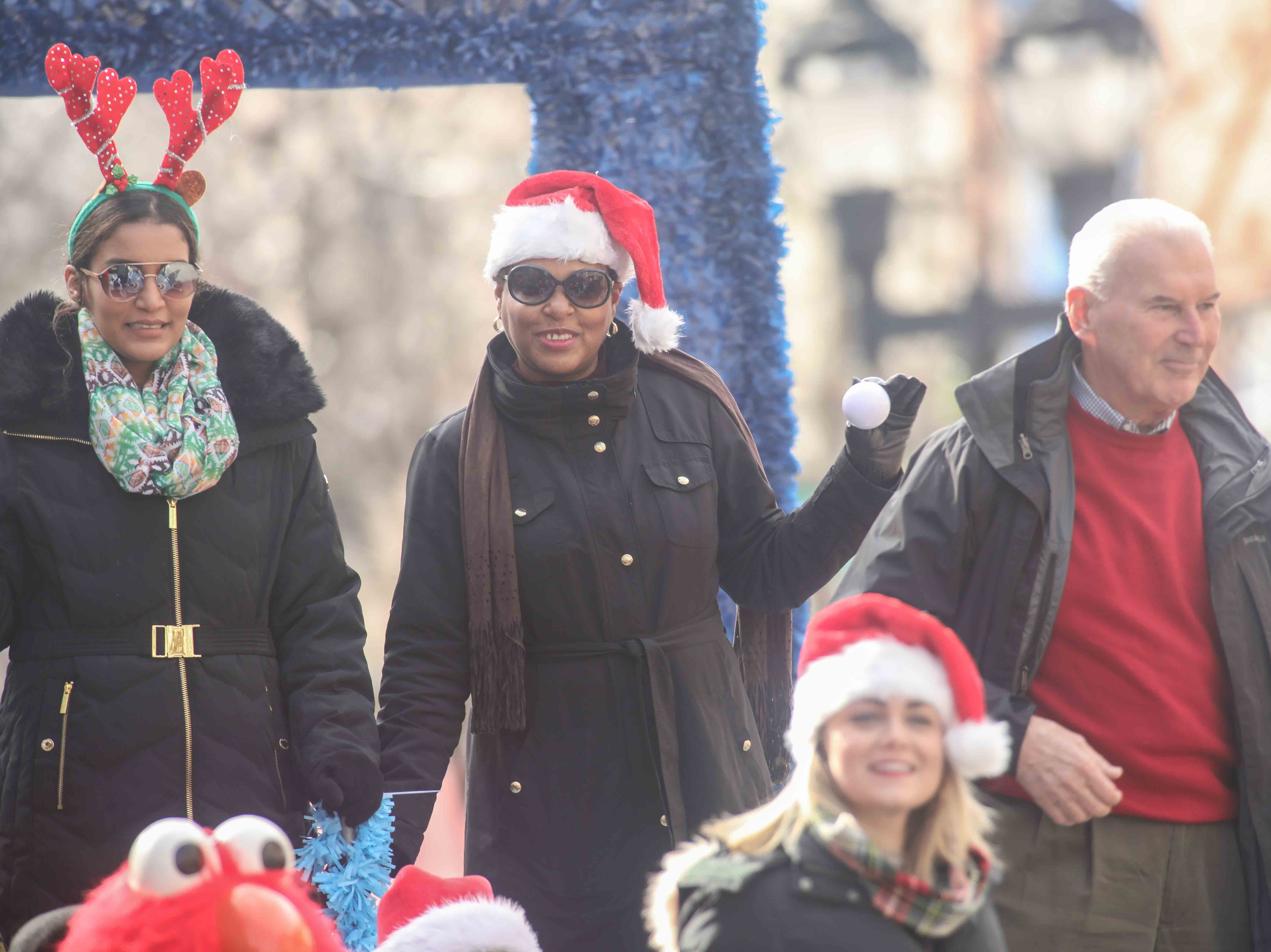From Left: Tanya Washington Chief of Staff, Mayor Michael S. Purzycki waves to spectators during the Wilmington Jaycees 55th Annual Christmas Parade along Market Street Saturday, Nov. 24, 2018, in Wilmington, Delaware.