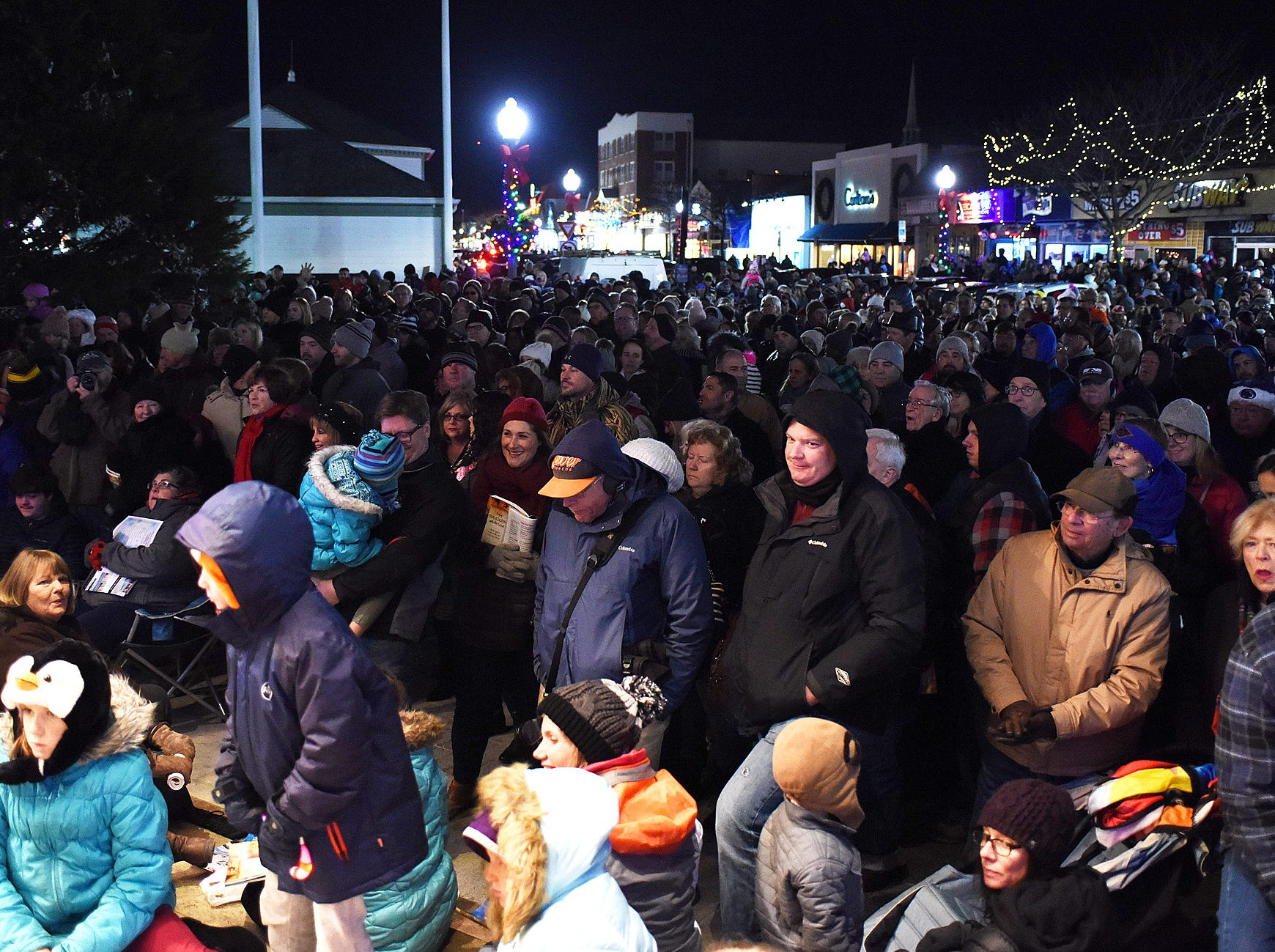 Under a full moon, several thousand visitors came out in the cold to sing Christmas carols and light Rehoboth Beach's Christmas tree on Friday night in downtown Rehoboth Beach. Clear Space Theater provided the musical selections as the tree donated by Pat and Paul Romaine was decorated with hundreds of lights.