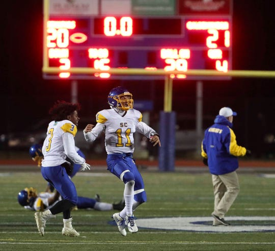 Sussex Central's Isaac Barnes (11) and Javon Toppin start the celebration as time runs out in Sussex Central's 21-20 win at Dover High School Friday in a DIAA Division I state high school tournament semifinal.