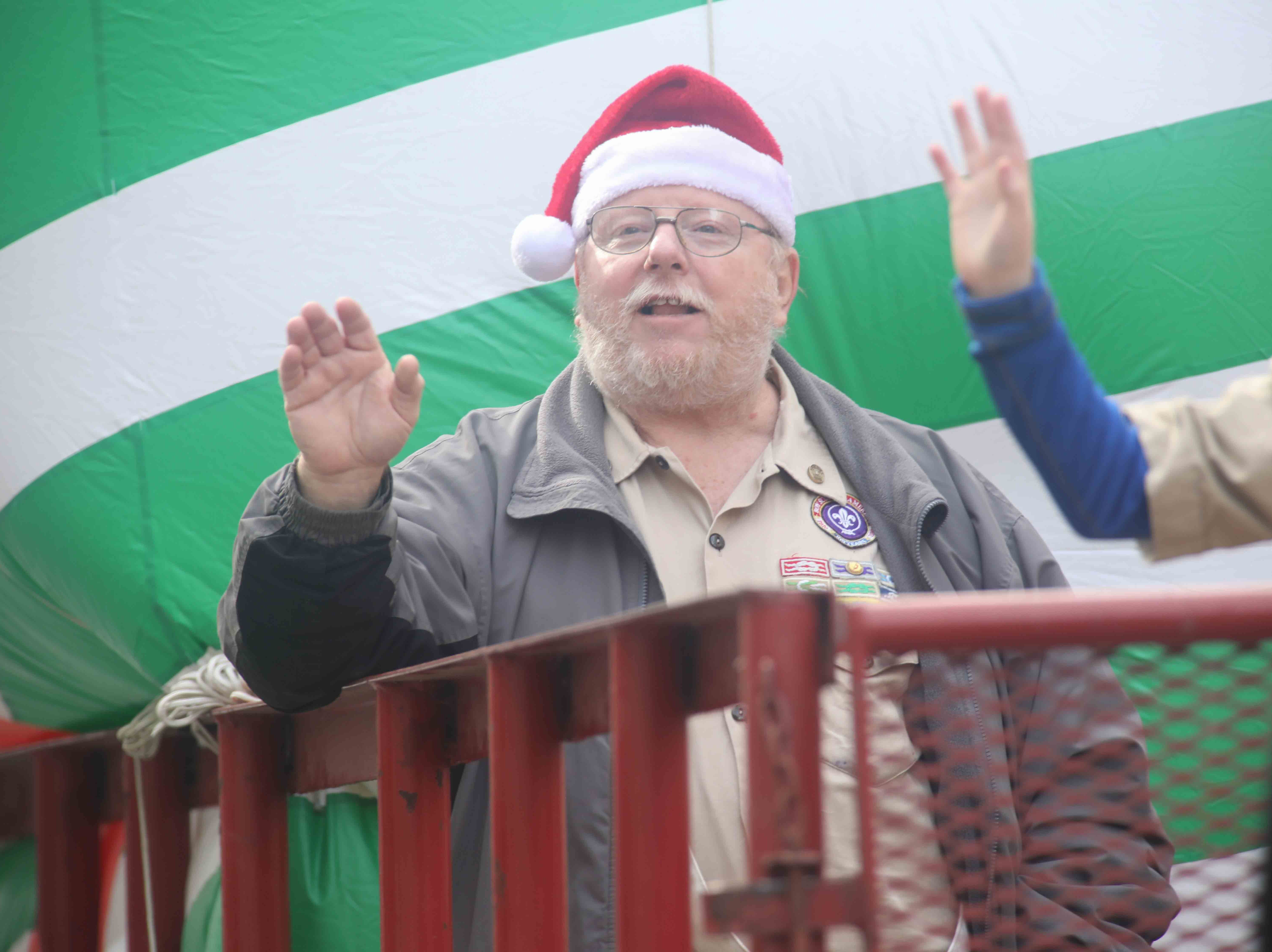 Spectators enjoy marching bands, floats, and of course, Santa during the Wilmington Jaycees 55th Annual Christmas Parade along Market Street Saturday, Nov. 24, 2018, in Wilmington, Delaware.