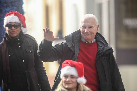 Mayor Michael S. Purzycki waves to spectators during the Wilmington Jaycees 55th Annual Christmas Parade along Market Street Saturday, Nov. 24, 2018, in Wilmington, Delaware.