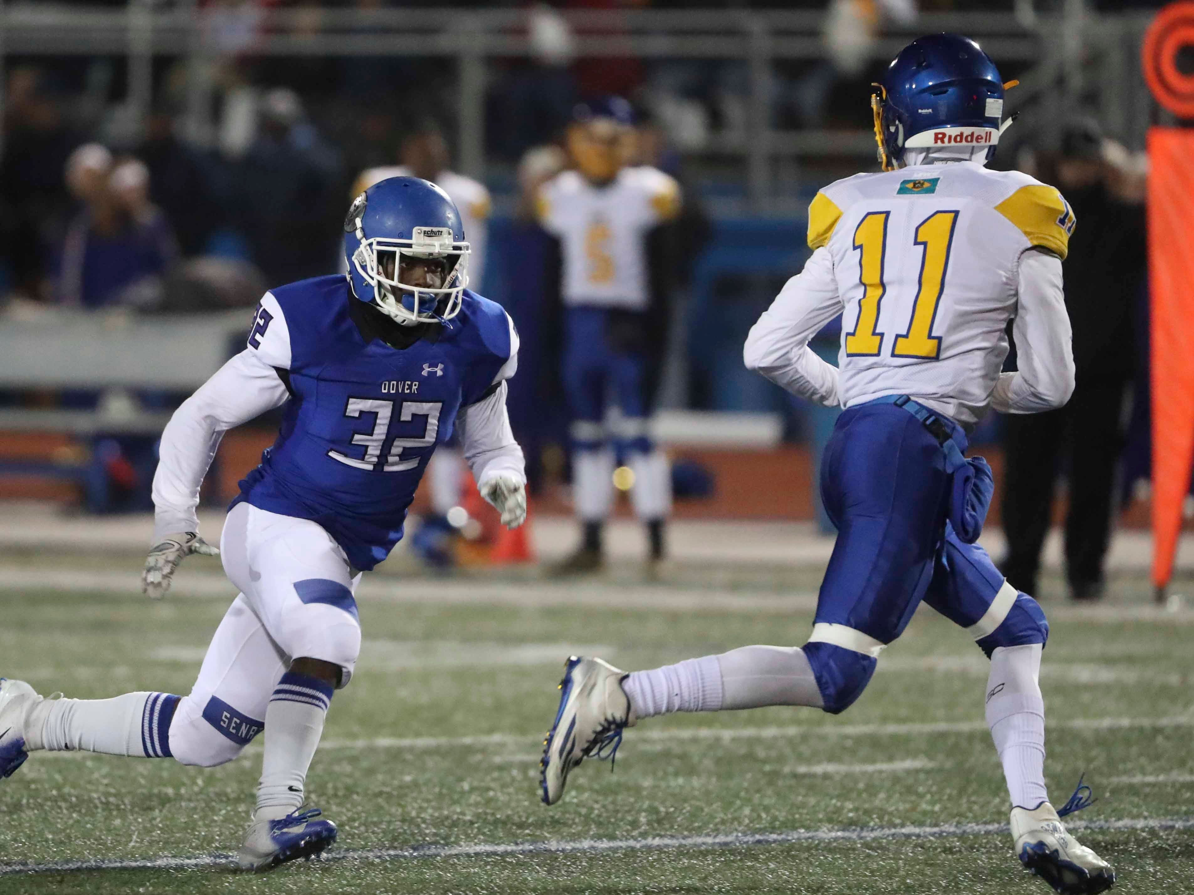 Dover's David Exum targets Sussex Central quarterback Isaac Barnes in the second  quarter of Sussex Central's 21-20 win at Dover High School Friday in a DIAA Division I state high school tournament semifinal.
