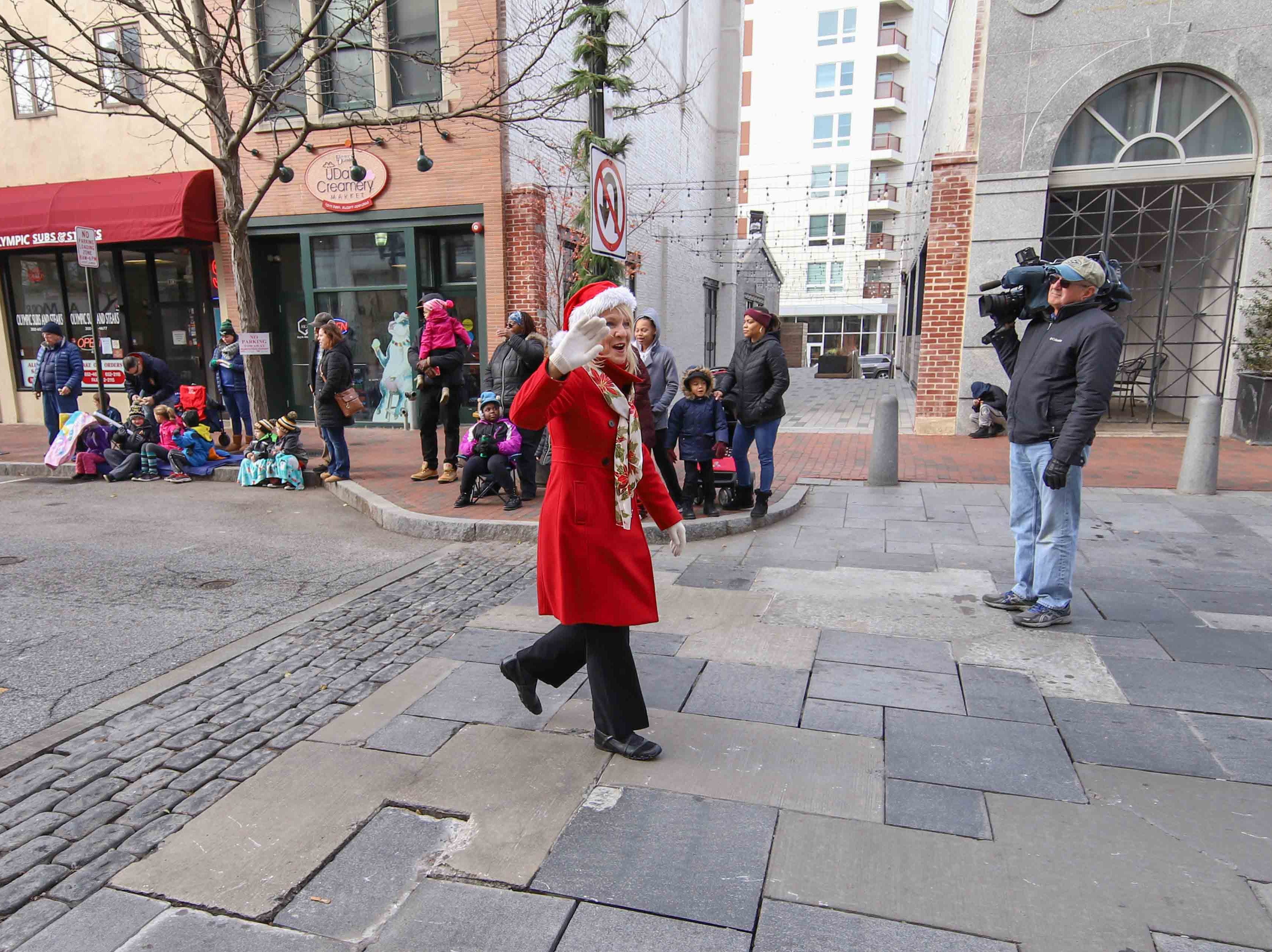 Delaware lieutenant governor Bethany Hall-Long waves to spectators during the Wilmington Jaycees 55th Annual Christmas Parade along Market Street Saturday, Nov. 24, 2018, in Wilmington, Delaware.