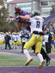 Delaware defensive back Tenny Adewusi breaks up a pass in the end zone intended for James Madison's Riley Stapleton in the first quarter at Bridgeforth Stadium during the opening round of the NCAA FCS playoffs Saturday.
