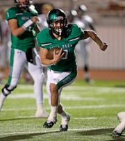 Iowa Park's Brendin Fallon (10) runs with the ball during the area round playoff game against Levelland, Friday, Nov. 23, 2018, at Tiger Stadium in Snyder, Texas.