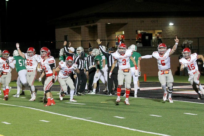 Holliday's defense celebrates a fumble recovery for a touchdown Friday night in Mineral Wells as the Holliday Eagles took on the Clifton Cubs in playoff action.