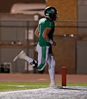 Iowa Park's Trent Green (1) runs the ball to score a touchdown during the area round playoff game against Levelland, Friday, Nov. 23, 2018, at Tiger Stadium in Snyder, Texas.