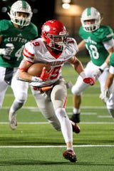 Holliday's Crue Jackson carries the ball for a gain Friday night in Mineral Wells as the Holliday Eagles took on the Clifton Cubs in 3A playoff action.