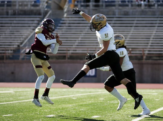 Rider defensive linemen Blake Stephenson, 51, and Isaiah Wetzel, 18, attempt to block a pass by El Paso Andress quarterback Jeremiah Tosky in the second half of the Region 1-5A Division II Area playoff game Friday at Ratliff Stadium in Odessa, TX. Photo by Edyta Blaszczyk for the Times Record News.