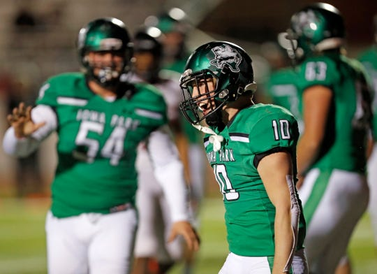 Iowa Park's Brendin Fallon (10) celebrates after scoring a touchdown during the area round playoff game against Levelland, Friday, Nov. 23, 2018, at Tiger Stadium in Snyder, Texas.